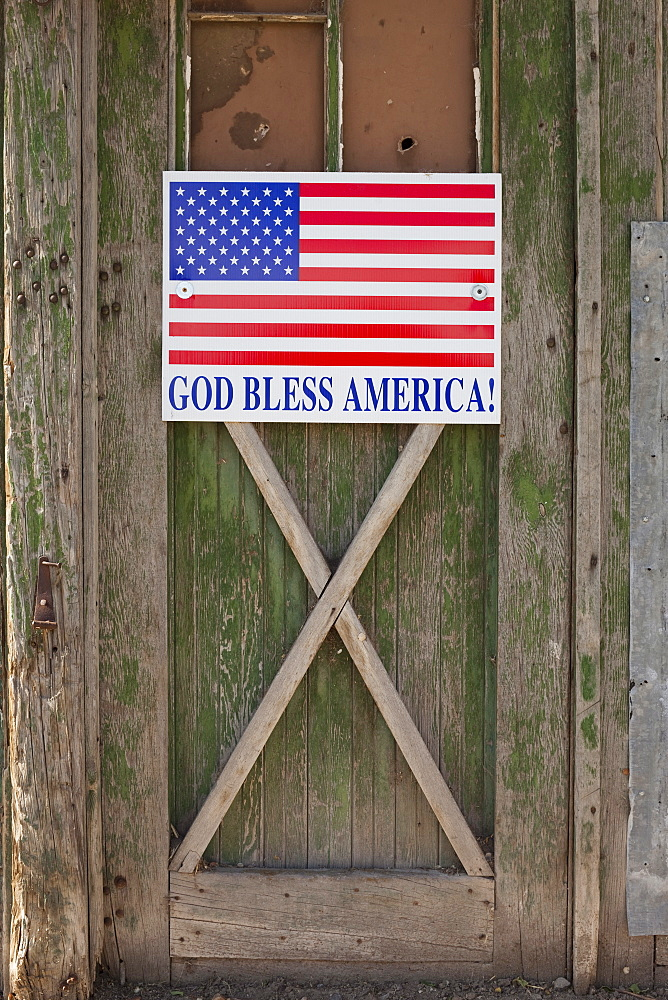 God bless American sign on barn door