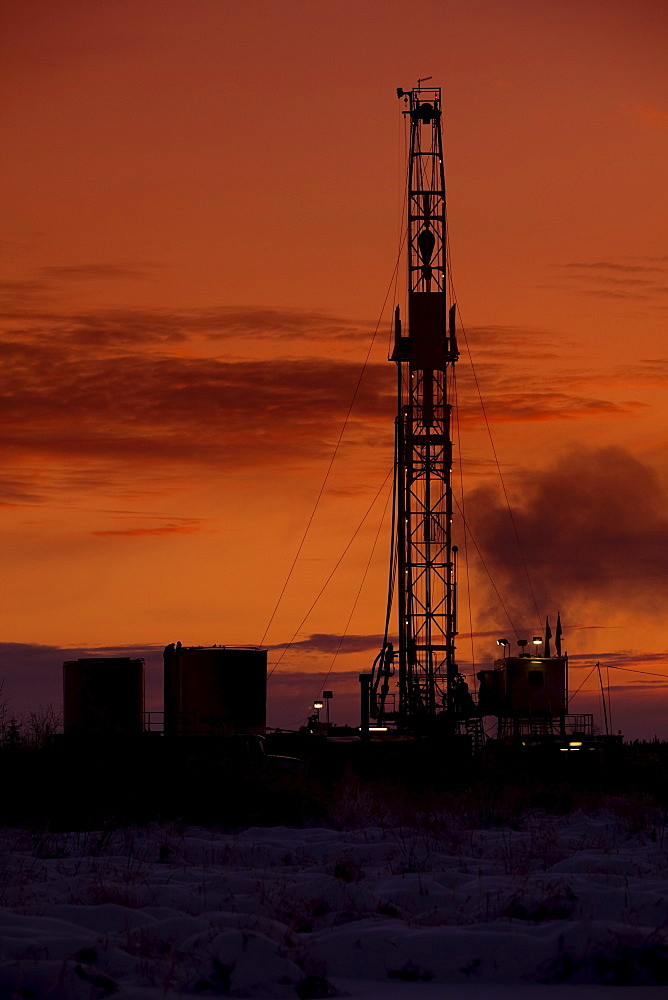 Oil drilling rig at dusk