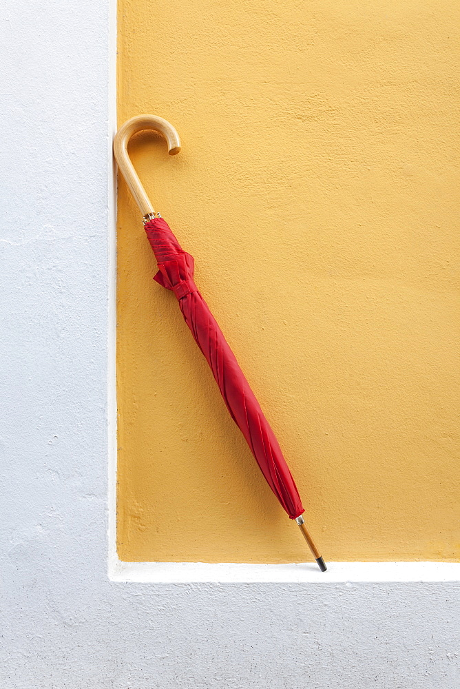 Red umbrella propped up against a wall in Old San Juan, Puerto RIco