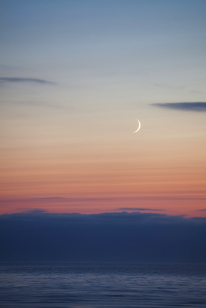 Crescent moon over the ocean, Winchester Bay, OR