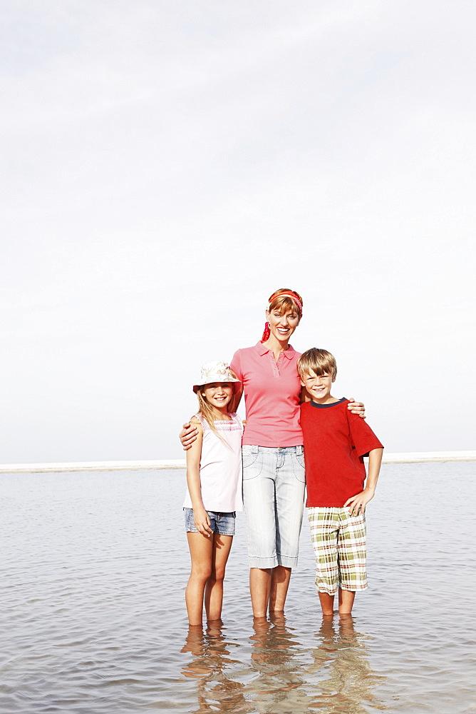 Family posing on beach