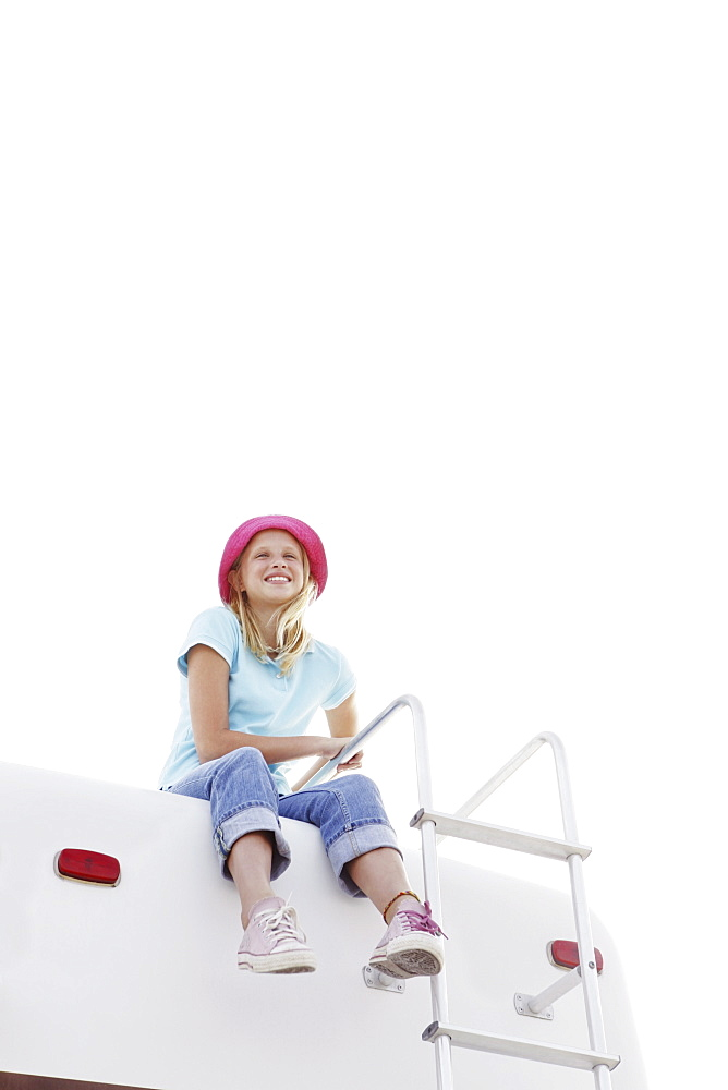 Girl sitting on top of motor home