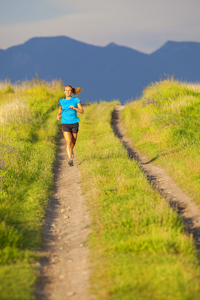 Front view of young woman jogging, Kalispell, Montana, USA