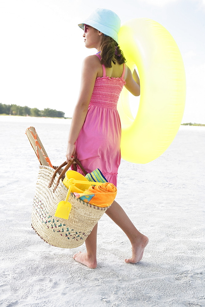 Girl carrying beach essentials