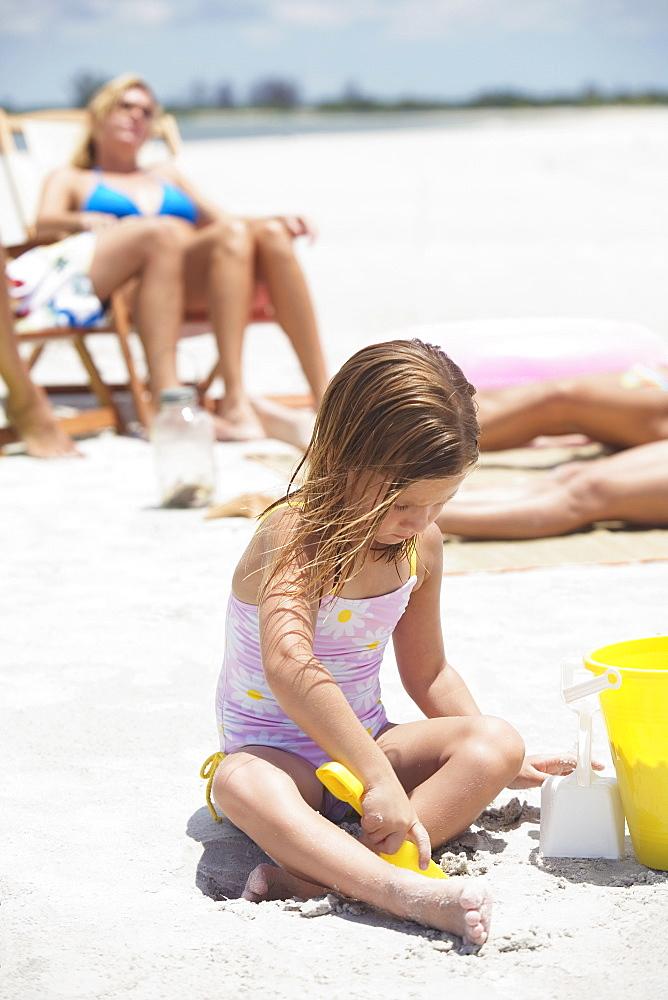 Family vacationing at beach
