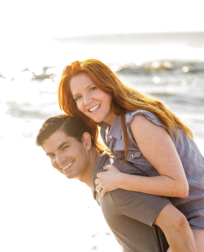 Portrait of couple on beach, Palm Beach, Florida