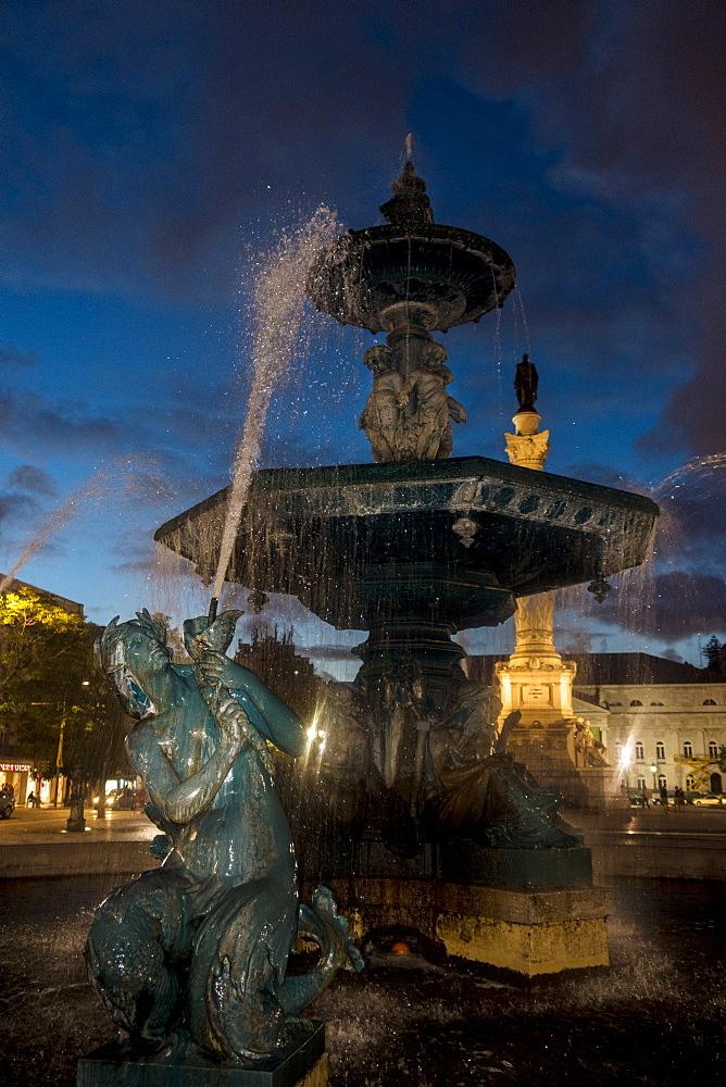 Fountain in Plaza de Pedro IV, Lisbon, Portugal