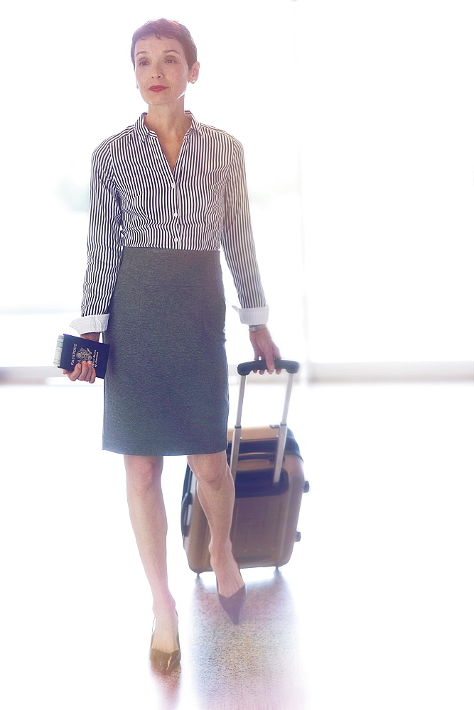 Senior business woman in airport