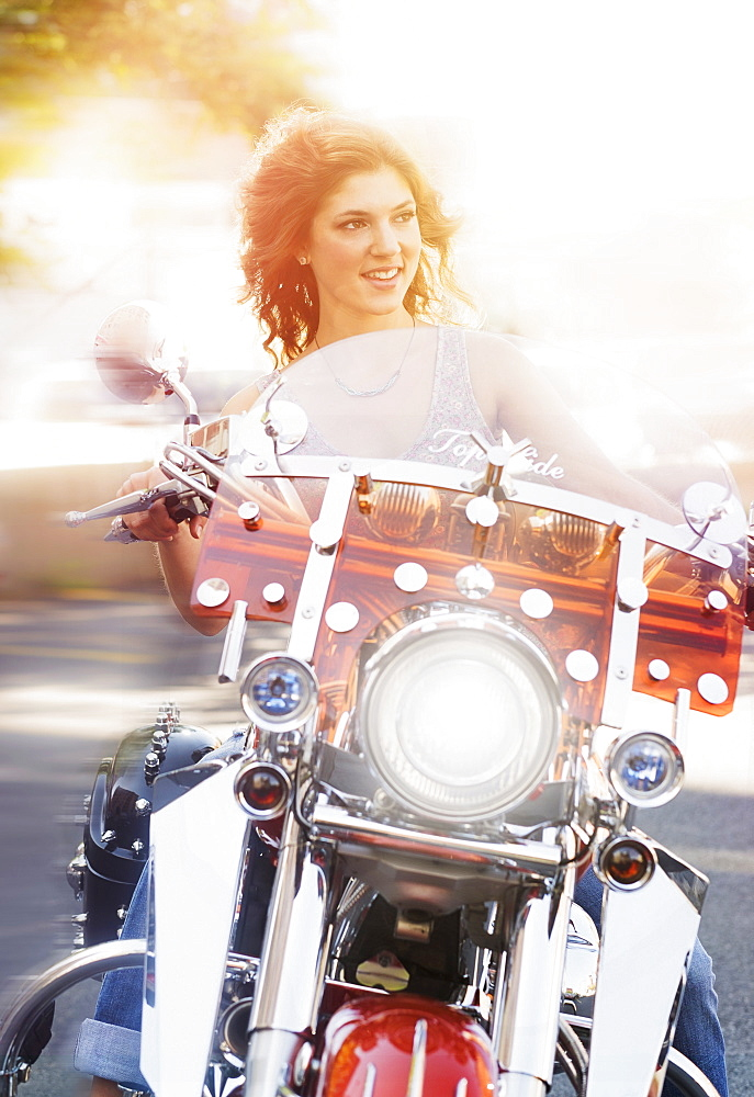 Young woman riding motorcycle