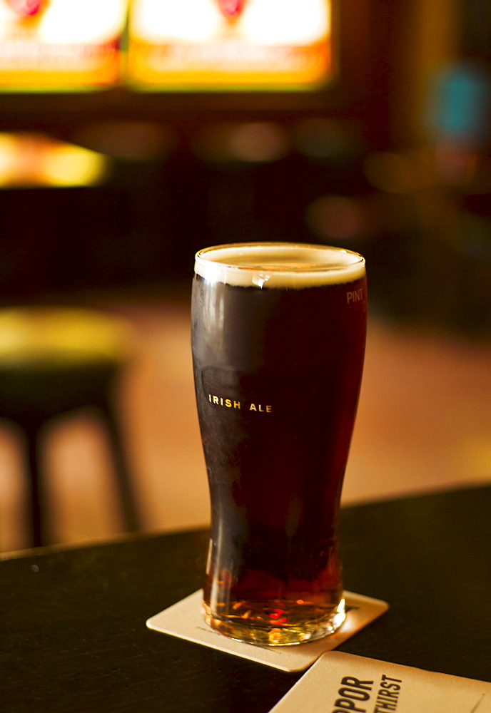 Glass of Irish ale in pub