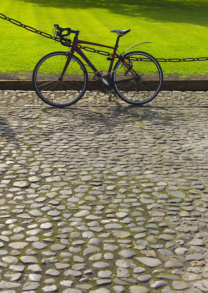 Bicycle on cobblestone path