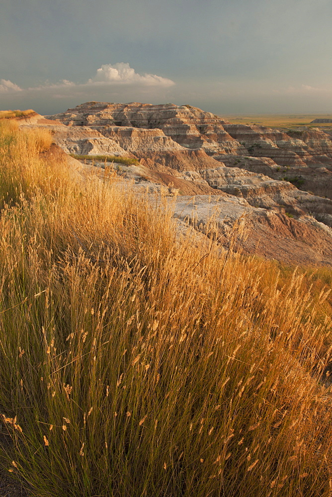 USA, South Dakota, Badlands National Park, Mountains with grass in foreground