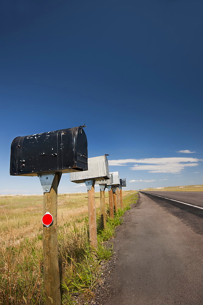 USA, South Dakota, Row of rural mailboxes on roadside