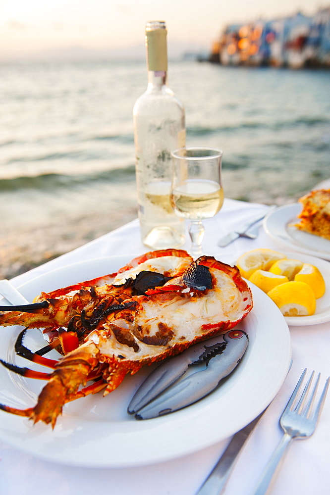 Greece, Cyclades Islands, Mykonos, Lobster dinner at coast