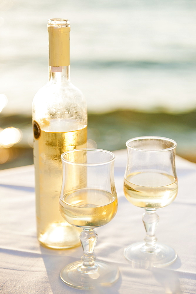 Greece, Cyclades Islands, Mykonos, Wine on table by sea