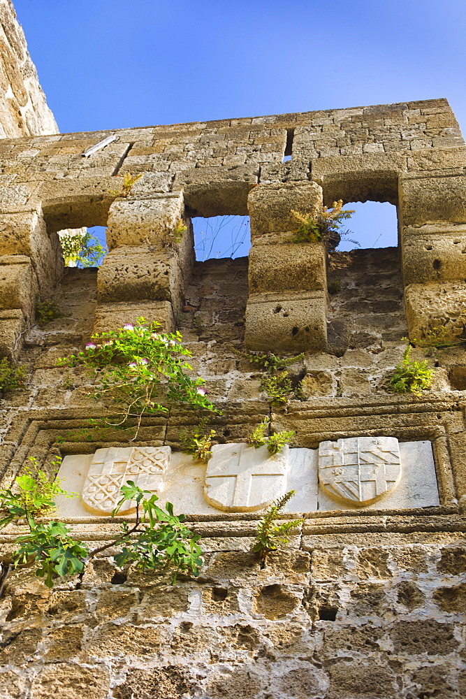 Greece, Rhodes, Medieval fortified wall with stone shields