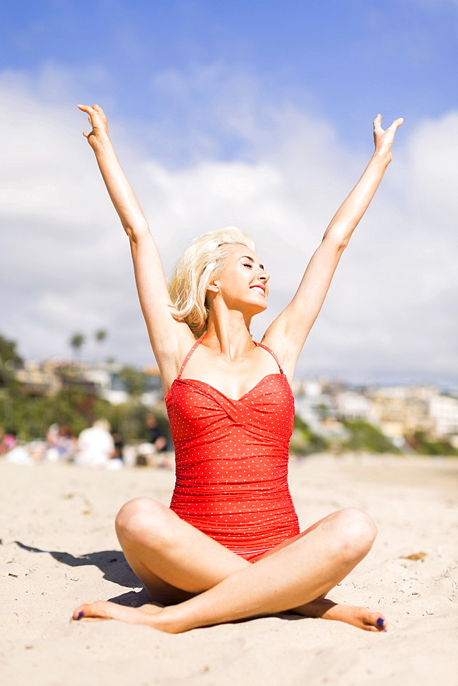 Portrait of blond woman on beach, Costa Mesa, California