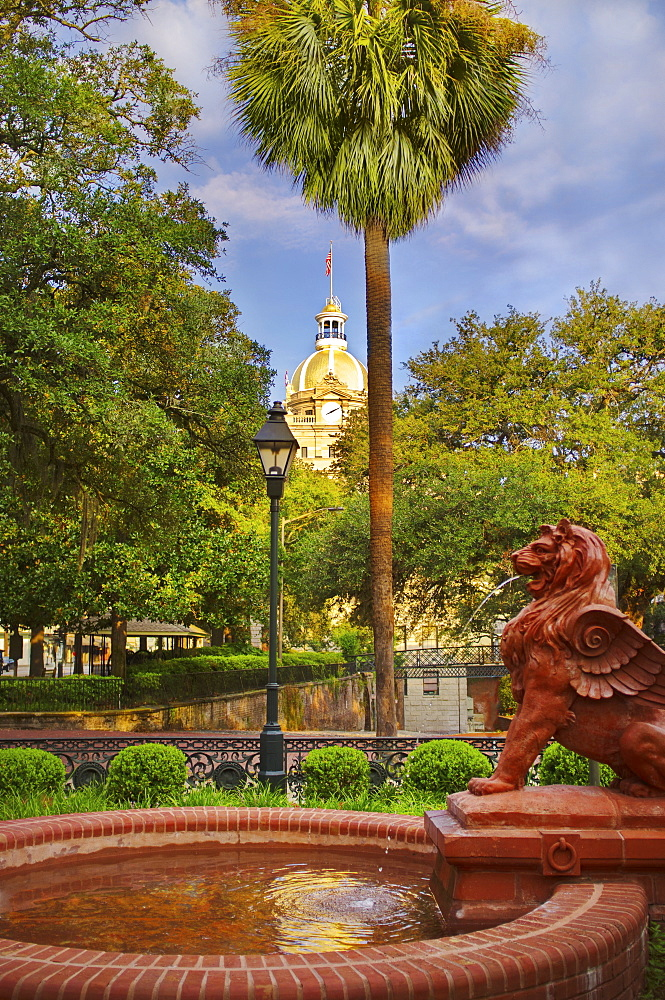 USA, Georgia, Savannah, Fountain in park with dome of City Hall in background