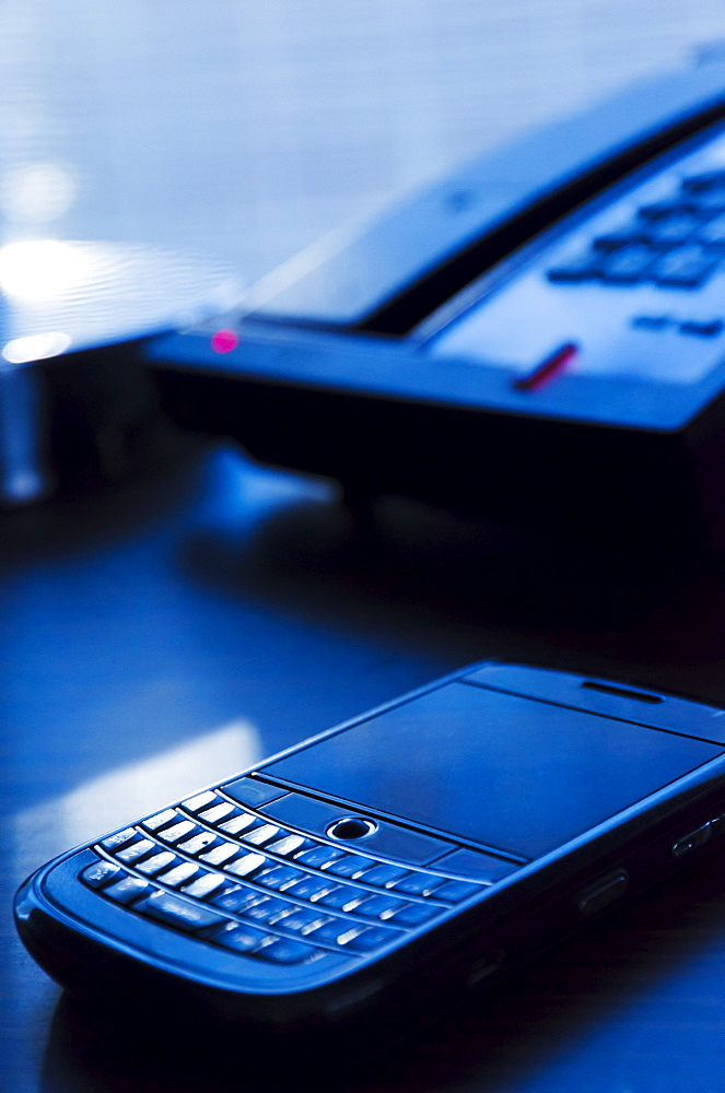 Close-up of mobile phone on desk