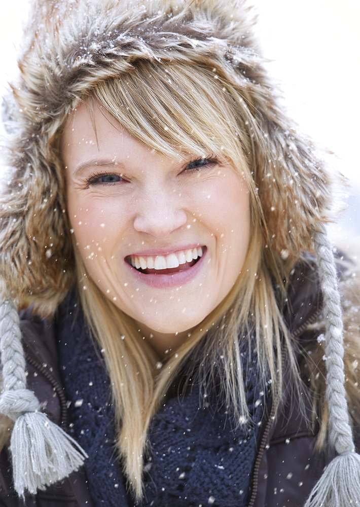 Portrait of woman wearing knit hat laughing