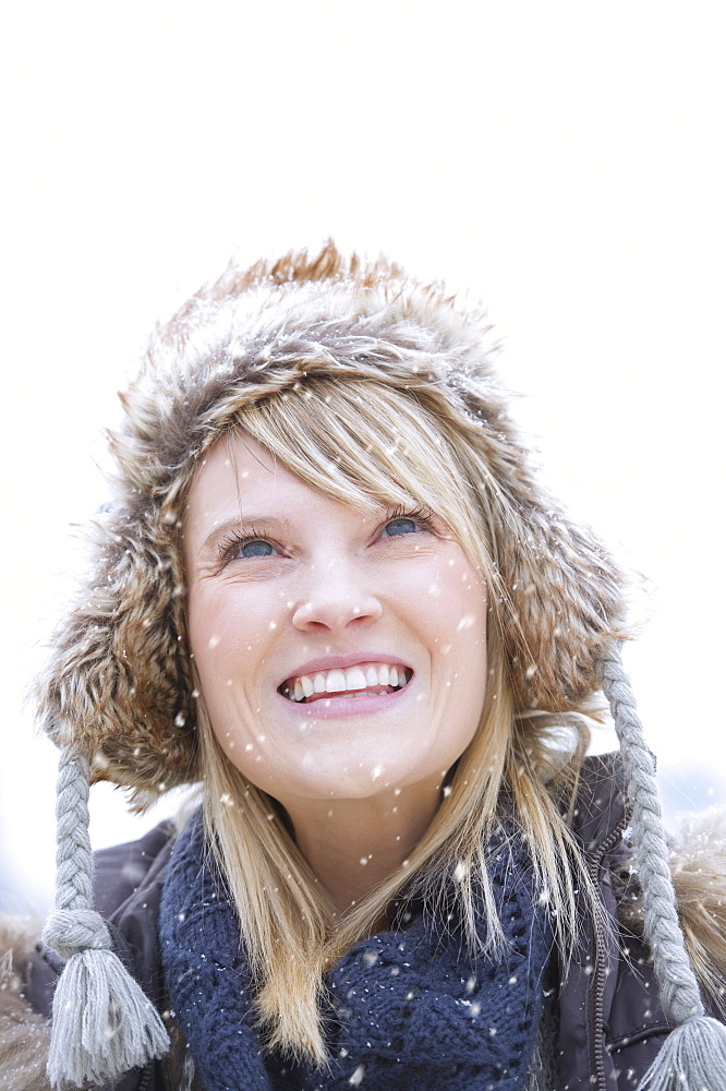 Portrait of woman wearing knit hat smiling