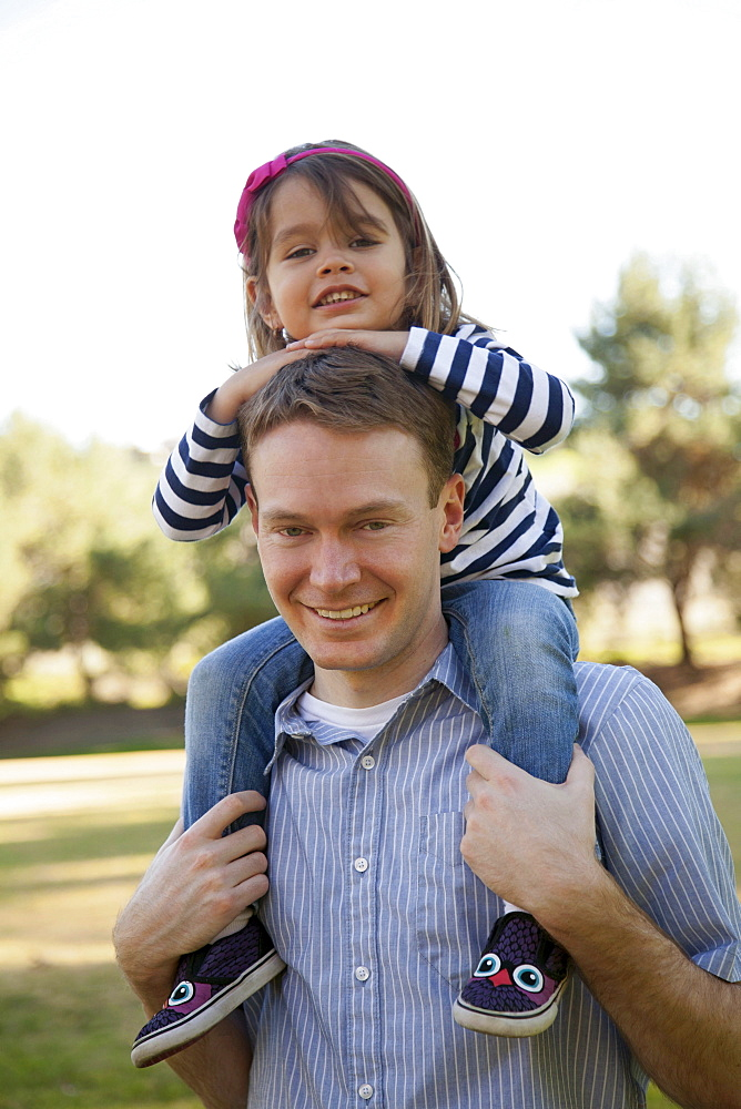 Father carrying his daughter (4-5 years) on holders, Irvine, California