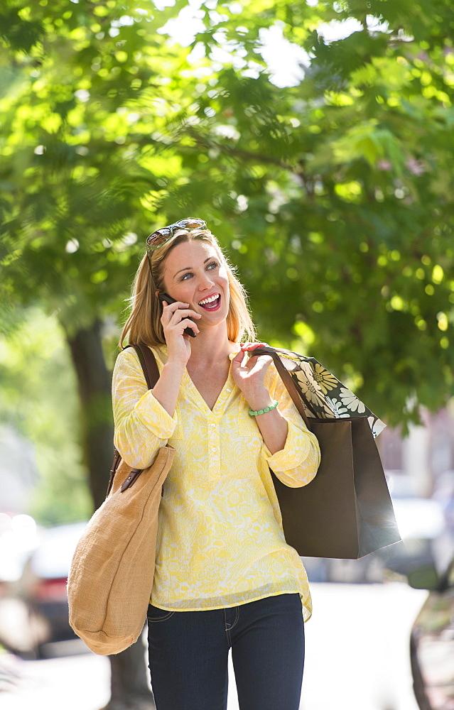 Woman walking in street, USA, New Jersey, Jersey City