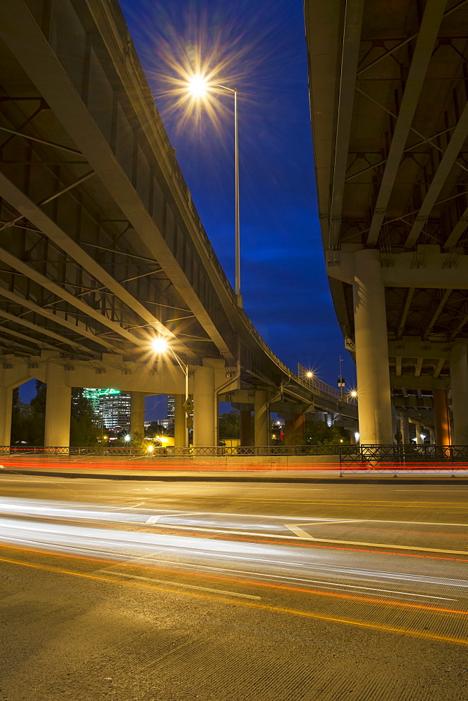 Low angle view of elevated highway overpass at night, Portland, Oregon