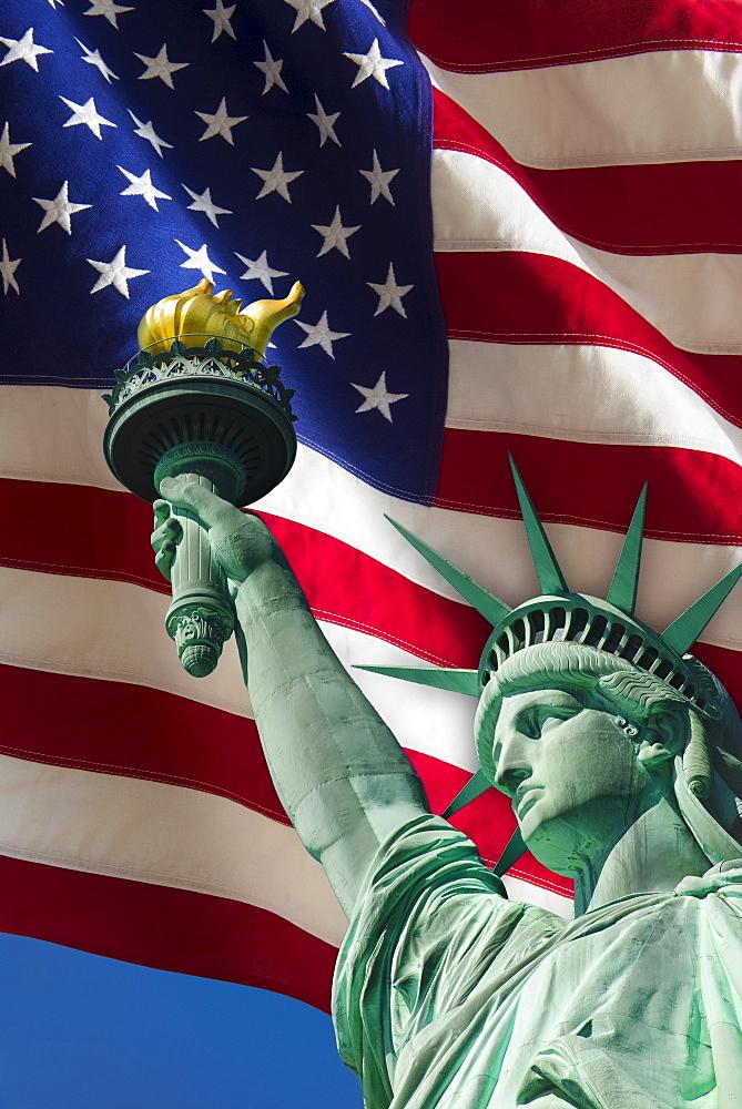 Statue of liberty under US flag, USA, New York City - 1178-15873
