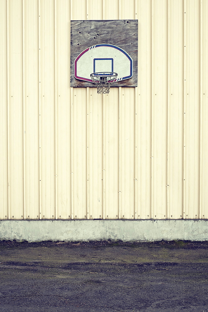 Basketball hoop on side of building in industrial area, Portland, Oregon