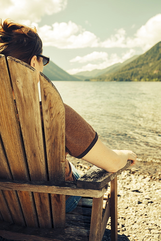Mature woman relaxing and looking at Lake Crescent, Olympic National Park, Washington