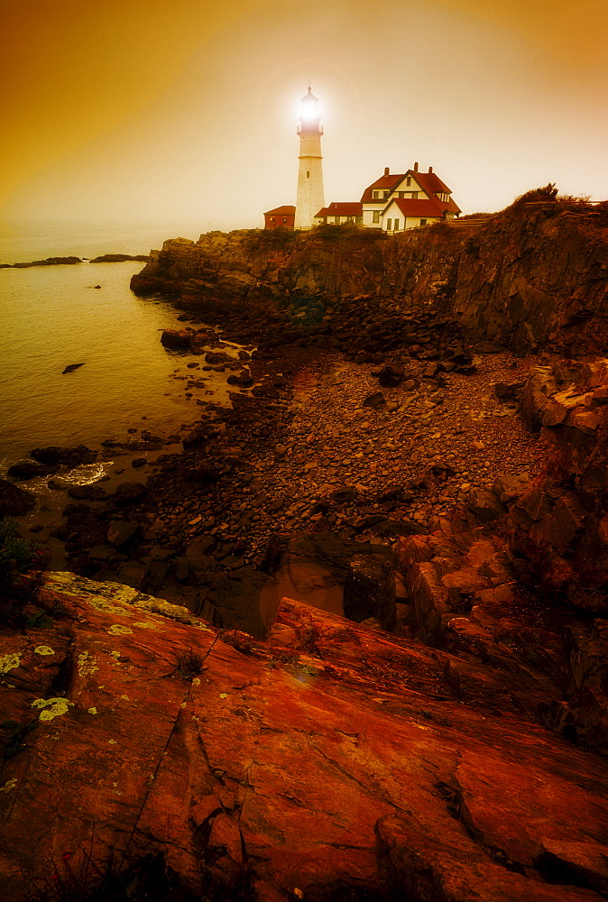 Remote coastline with lighthouse, Portland, Maine