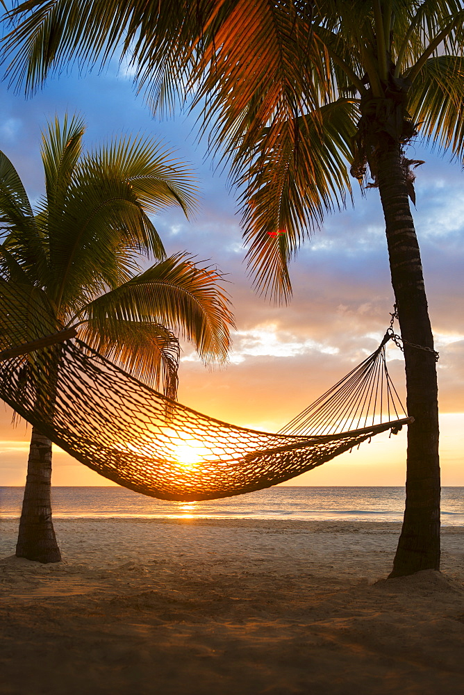 Hammock on beach at sunset, Jamaica