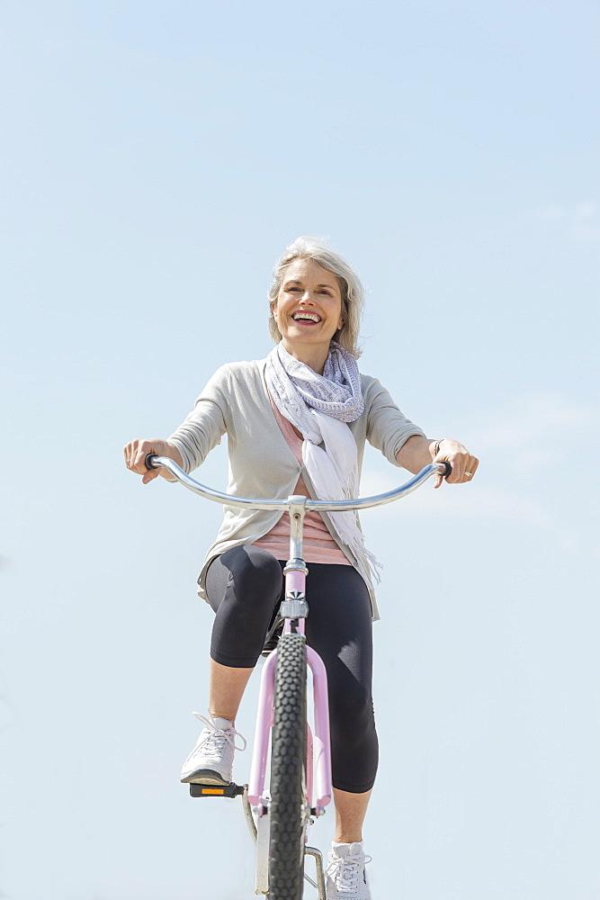 Senior woman riding bicycle