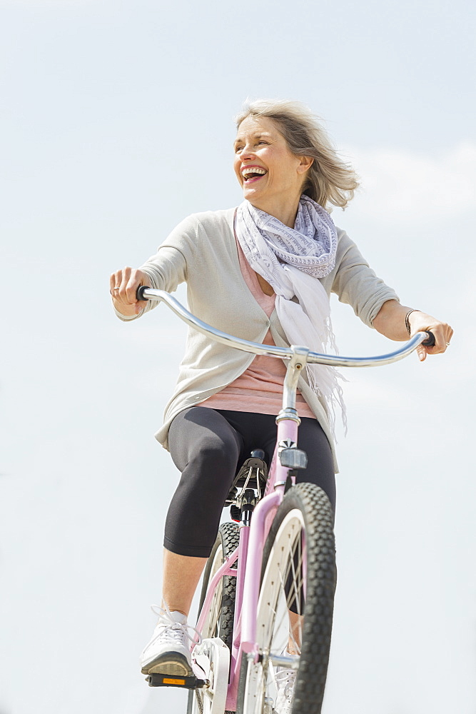 Senior woman riding bicycle