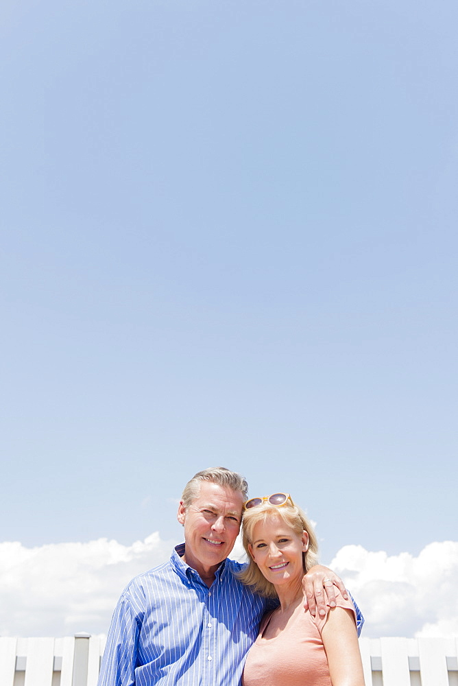 Portrait of smiling couple against sky, Jersey City, New Jersey