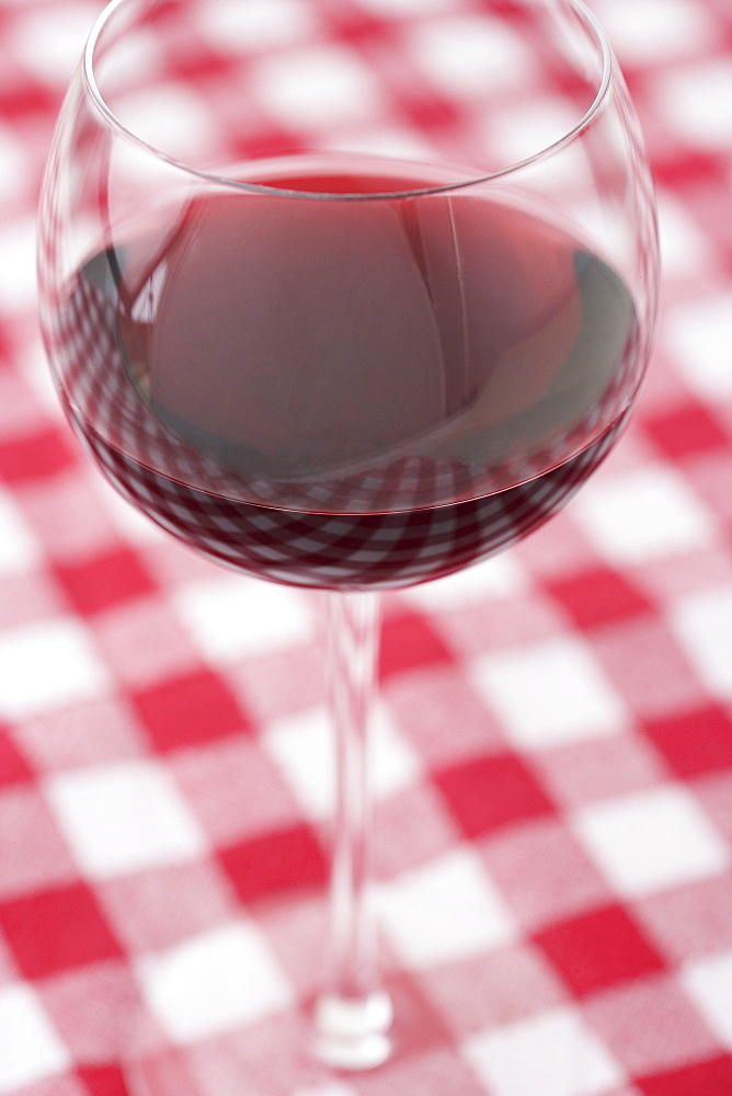Glass of wine on checkered tablecloth