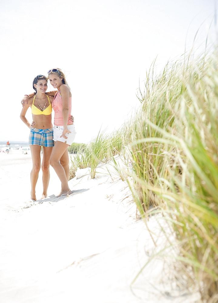 Women standing on beach