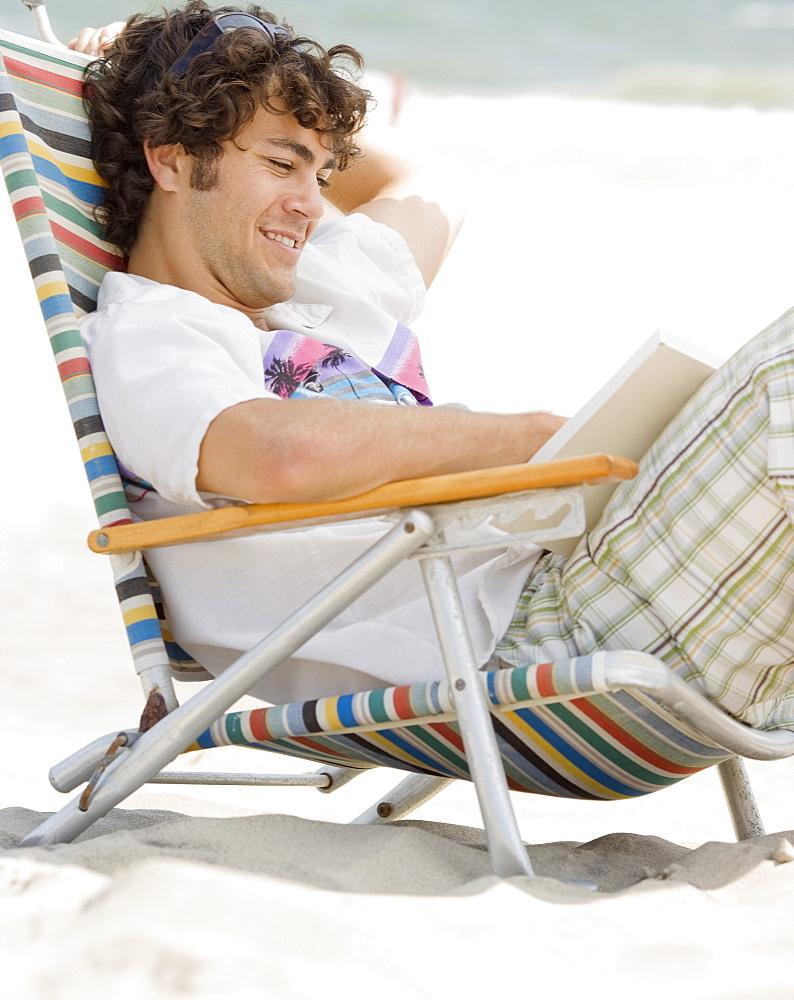 Man reading at beach