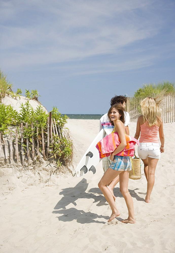 Friends walking onto beach