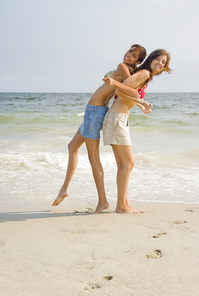 Two young women playing at beach