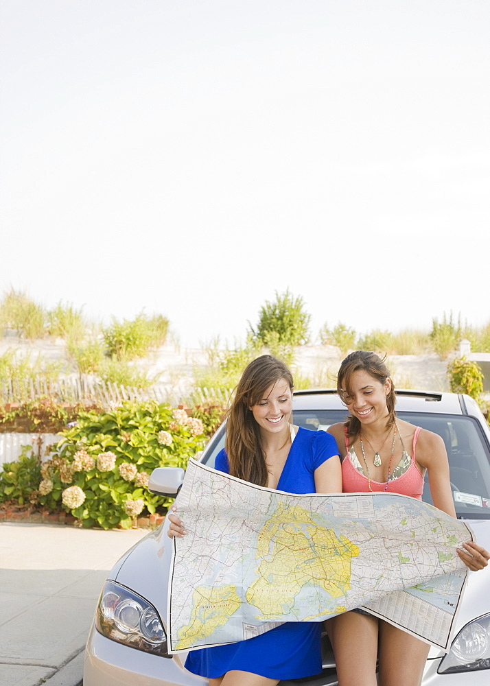 Young women looking at map