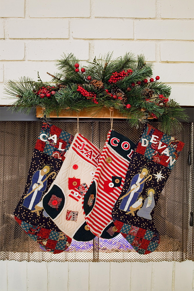 Christmas stockings hanging on fireplace