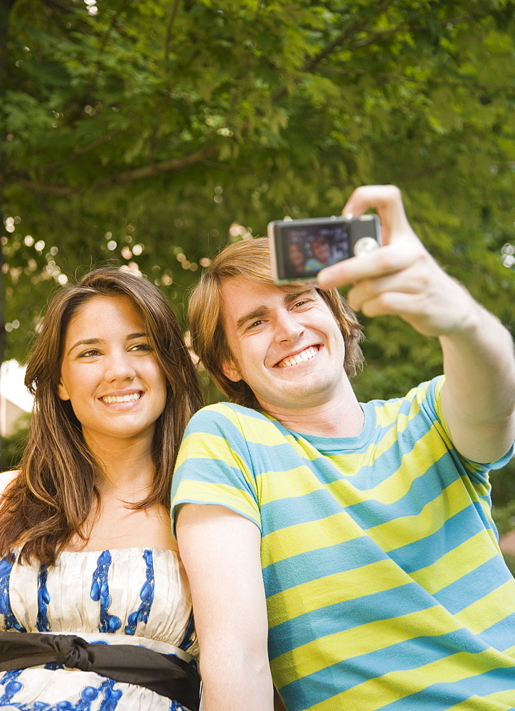 Couple taking own photograph