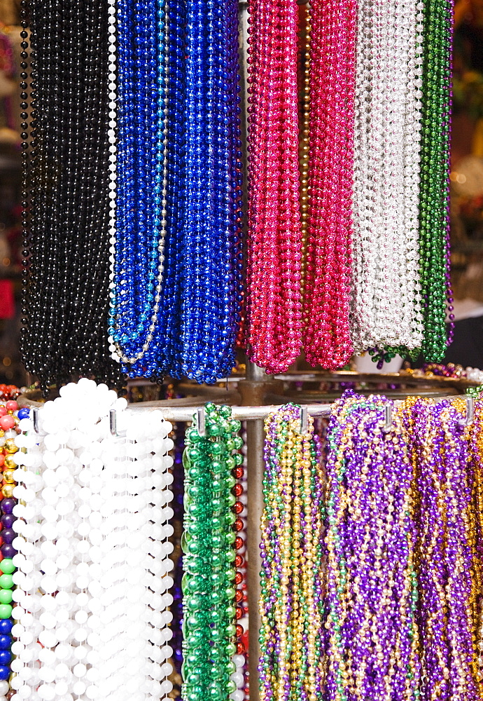 Bead necklaces hanging on rack, French Quarter, New Orleans, Louisiana, United States