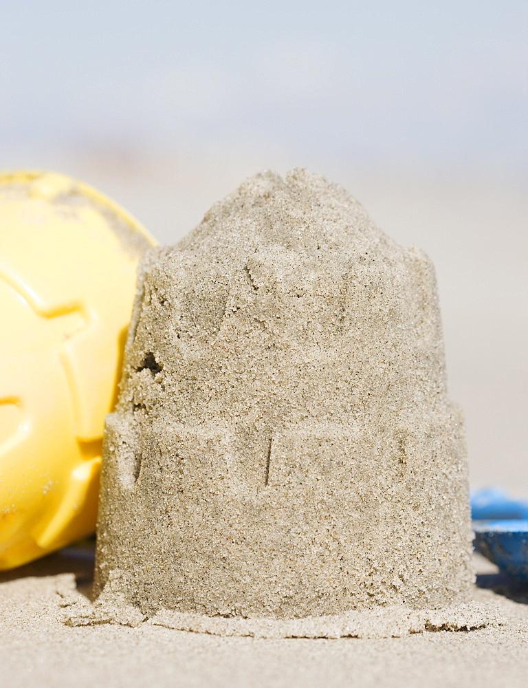 Sand castle mold on beach