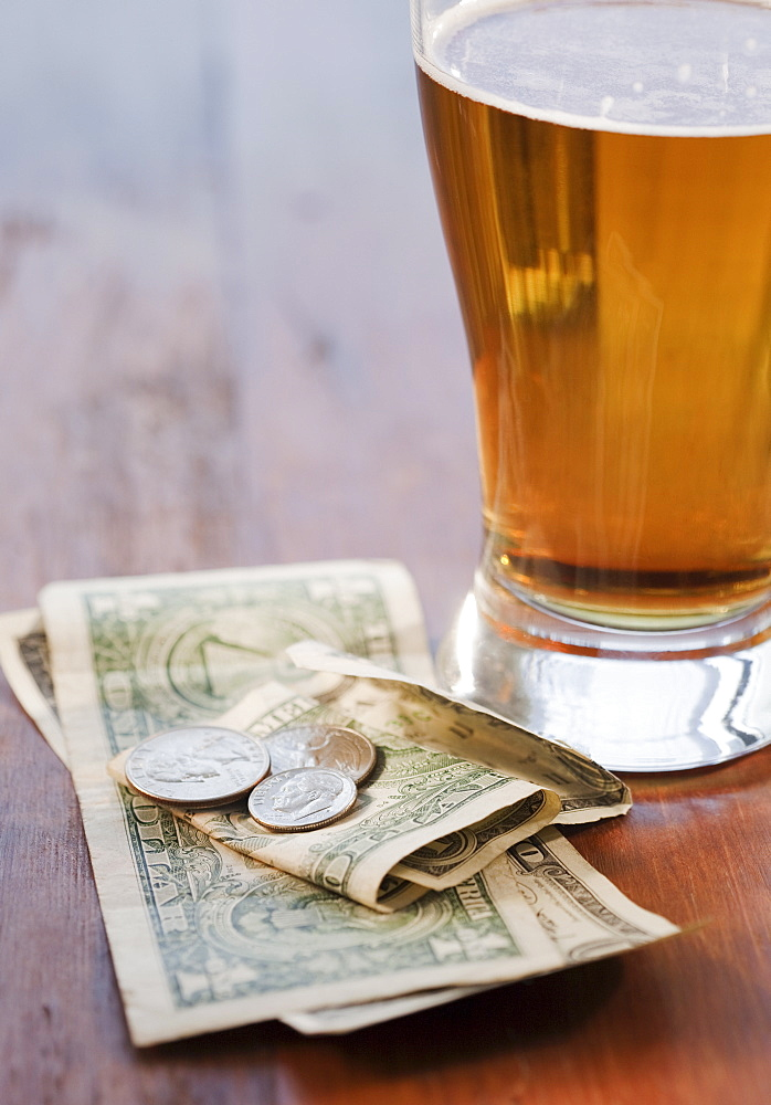 Close up of beer and money