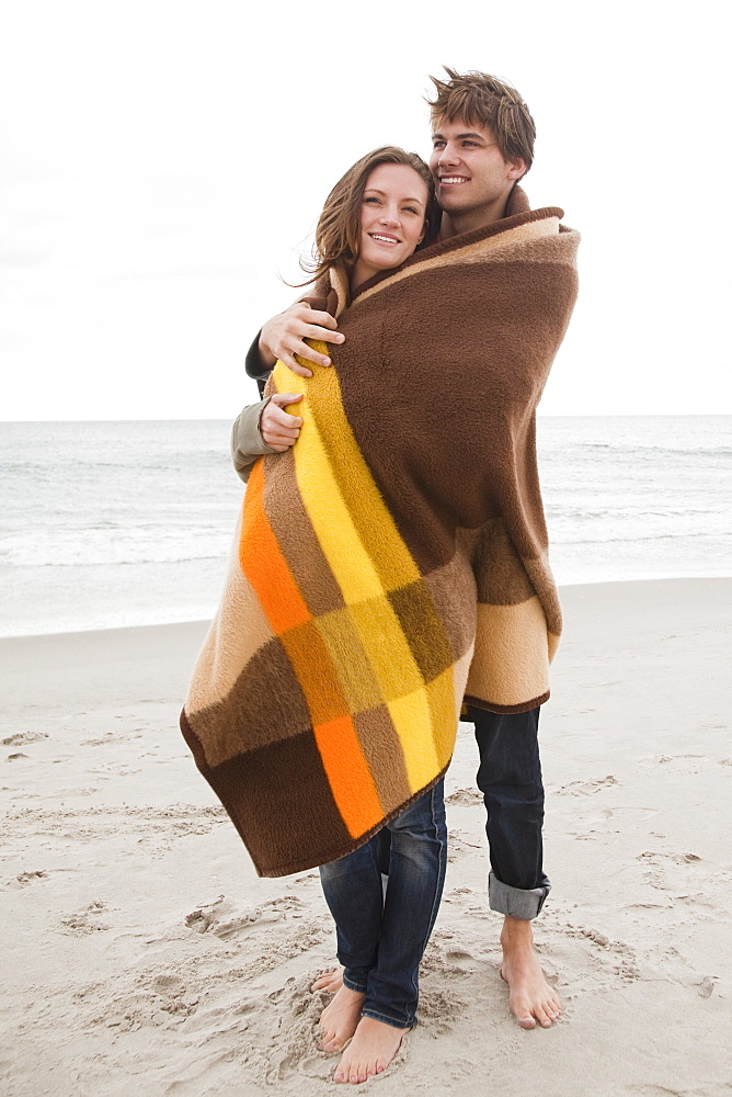 Couple wrapped in blanket