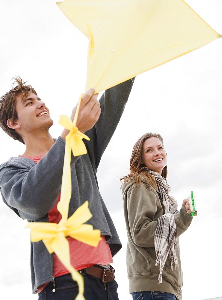 Couple flying kite
