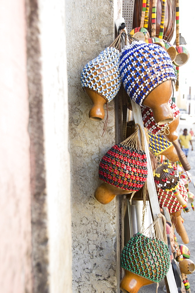 Brazil, Bahia, Salvador De Bahia, Rattles hanging against wall, close-up